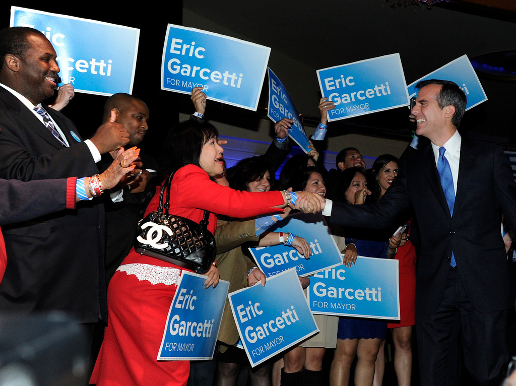 . Los Angeles Mayoral candidate Eric Garcetti enters the room for his speech. Garcetti held his election night party at The Hollywood Palladium where supporters showed hear him speak. Hollywood, CA 5/22/2013(John McCoy/LA Daily News)