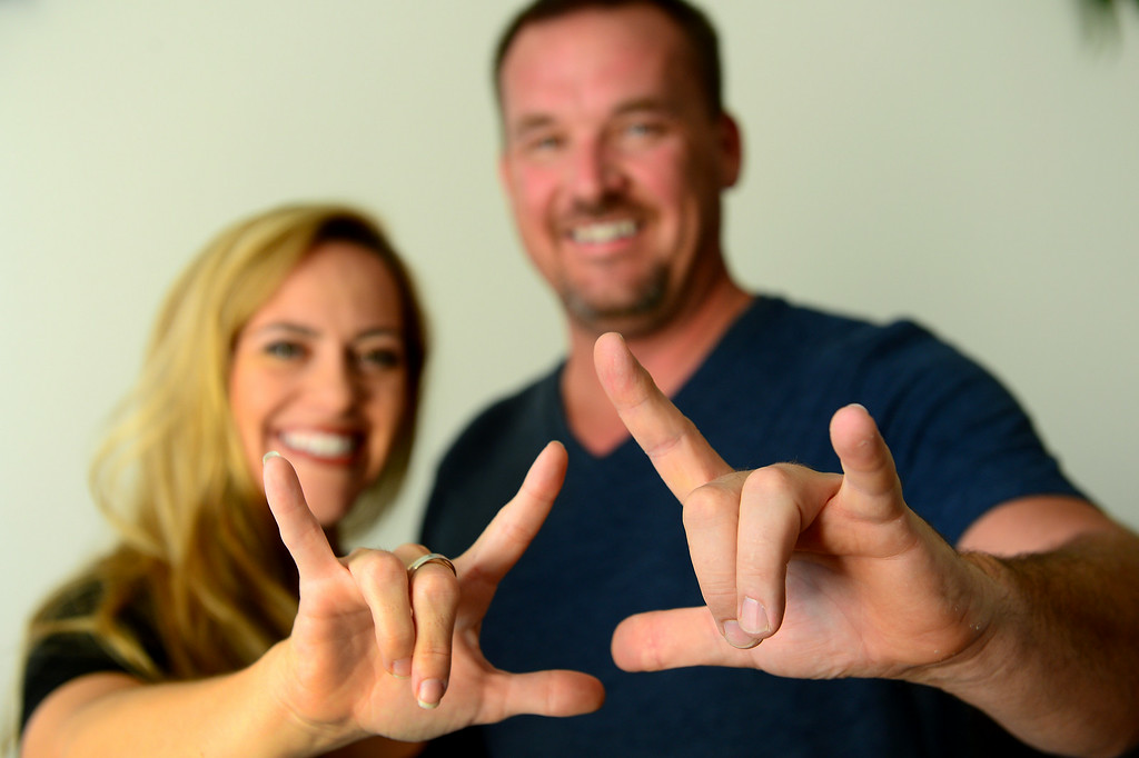 """. Tina Cleveland and Paul Sirimarco sign \""""I love you.\"""" Videos of the Chatsworth couple performing sign-language videos of hit songs have become popular on YouTube. (Photo by Michael Owen Baker/Los Angeles Daily News)"""