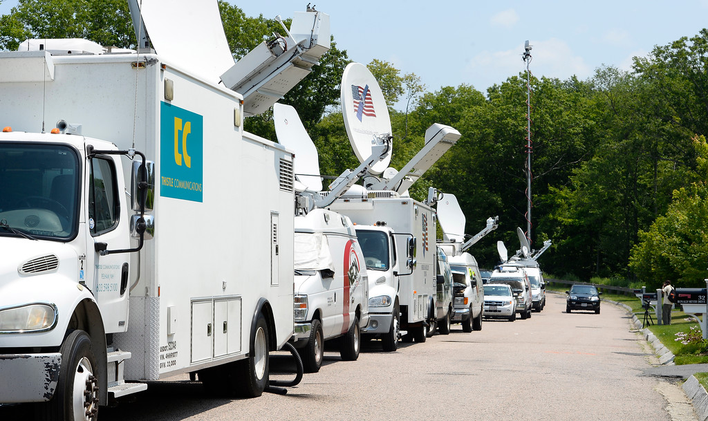 . Vehicles of the news media are set up on the street across from the home of New England Patriots tight end Aaron Hernandez in North Attleboro, Massachusetts, USA, 21 June 2013. The body of 27-year-old Odin Lloyd, a semi-pro football player and an acquaintance of Hernandez, was found 17 June 2013 in a industrial area about 1 mile (1.6 km) from the home of Hernandez. According to media reports, police have issued an arrest warrant for Hernandez on alleged obstruction of justice charges.  EPA/CJ GUNTHER