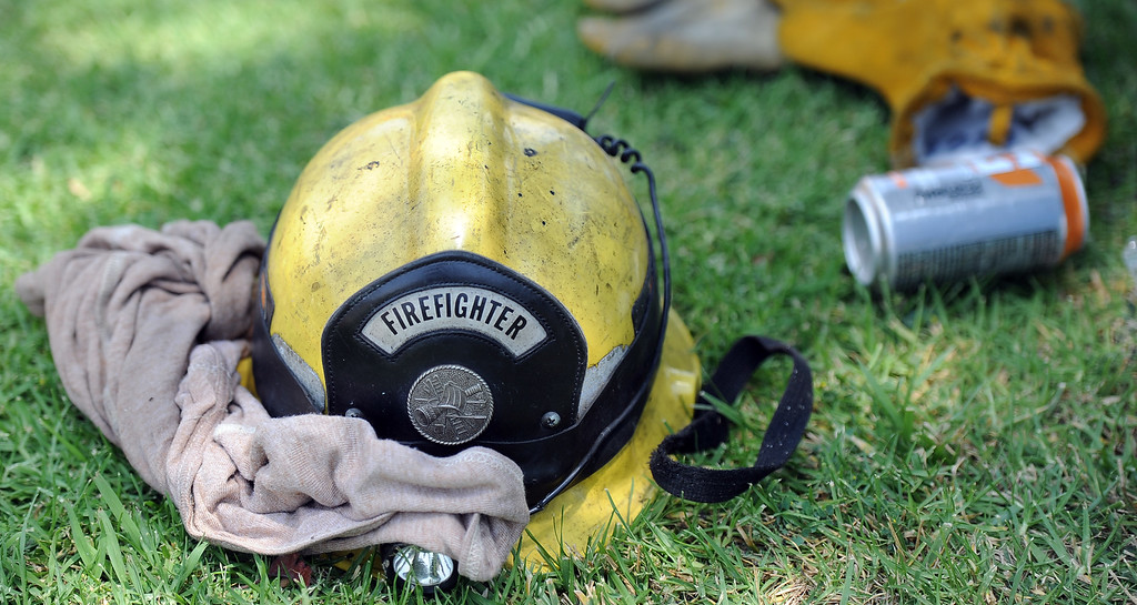. Los Angeles County firefighter helmet as they battle 3-alarm fire at an abandoned warehouse near 9th Avenue and Clark Avenue on Tuesday, July 9, 2013 in City of Industry, Calif.  (Keith Birmingham/Pasadena Star-News)