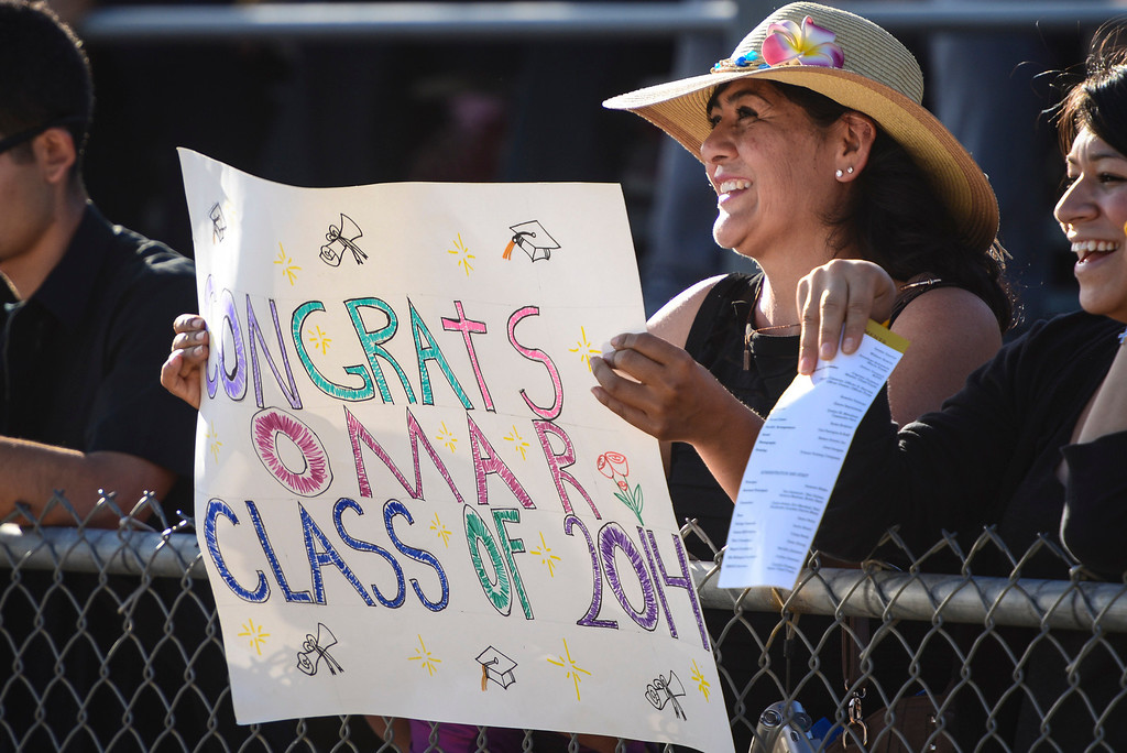 . Maria Quezada celebrates the grads of Kennedy High school at graduation ceremonies Thursday, June 5, 2014.   ( Photo by David Crane/Los Angeles Daily News )