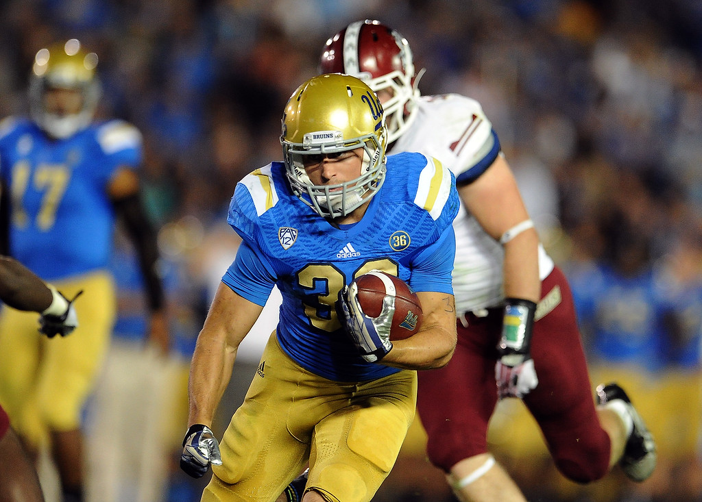 . UCLA\'s Steven Manfro (33 runs for a touchdown against New Mexico State during the first half of their college football game in the Rose Bowl in Pasadena, Calif., on Saturday, Sept. 21, 2013.   (Keith Birmingham Pasadena Star-News)