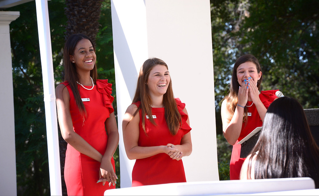 . Rose Princesses, from left, Nicole Nelam, Madison Teodo and Tracy Cresta give advice to contestants as the Tournament of Roses holds their annual Royal Court Tryouts Saturday, September 14, 2013 at the Tournament House in Pasadena for the 125th Rose Parade. A thousand young women from the Pasadena area schools are expected to tryout. Tryouts continue Monday from 3 to 5 p.m.   (Photo by Sarah Reingewirtz/Pasadena Star-News)