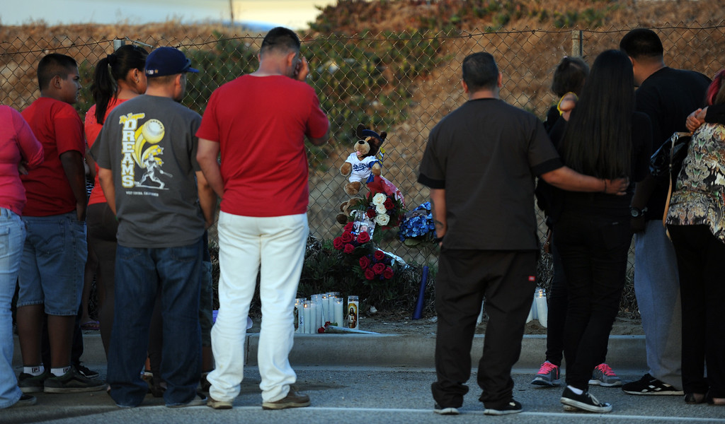 . A make shift memorial during a vigil for those who died in a car crash including  two children and a man along the 3500 block of San Gabriel River Road on Friday, June 14, 2013 in Industry, Calif.  (Keith Birmingham/Pasadena Star-News)