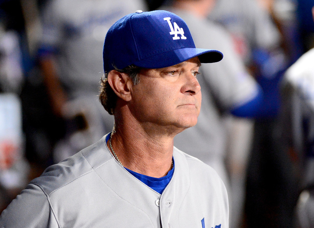 . Los Angeles Dodgers\' Manager Don Mattingly watches his team defeat the Atlanta Braves 6-1 in the first game of the playoffs Thursday, October 3, 2013 at Turner Field in Atlanta, Georgia. (Photo by Sarah Reingewirtz/Pasadena Star- News)