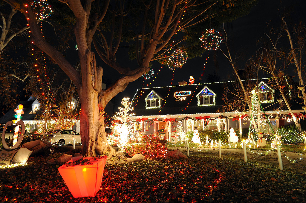 """. Many houses with elaborate holiday displays can be located in the \""""Candy Cane Lane\"""" area of Woodland Hills, CA December 17, 2013.  Candy Cane Lane is located near Lubao Avenue and Oxnard Street and consists of eight square-blocks that is annually transformed into a celebration of lights, figures and artificial snow.(Andy Holzman/Los Angeles Daily News)"""