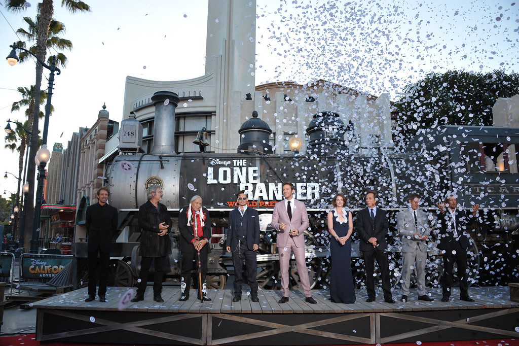 ". From left, Jerry Bruckheimer, Gore Verbinski, Saginaw Grant, Johnny Depp, Armie Hammer, Ruth Wilson, William Fichtner, James Badge Dale, and Barry Pepper appear on stage at the world premiere of ""The Lone Ranger\"" at Disney California Adventure on Saturday, June 22, 2013 in Anaheim, Calif. (Photo by John Shearer/Invision/AP)"