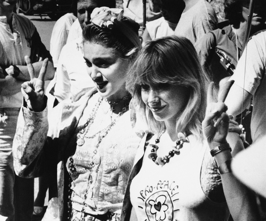 ". Rock star Madonna, left, and Rosanna Arquette make the ""Peace Sign,\"" on Saturday, Oct. 5, 1985 in Los Angeles during the taping of a television commercial promoting a cross country peace march. (AP Photo/Jim Ruyman)"