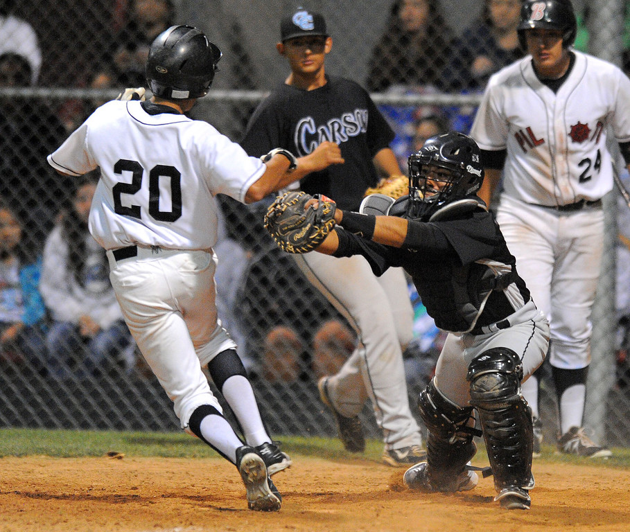 . WILMINGTON - 05/02/2013  (Photo: Scott Varley, Los Angeles Newspaper Group)  Carson vs Banning baseball at Banning High. Banning\'s Andre Villarreal escapes the tag by Carson catcher Mark Torressillas in the 4th inning for a run.