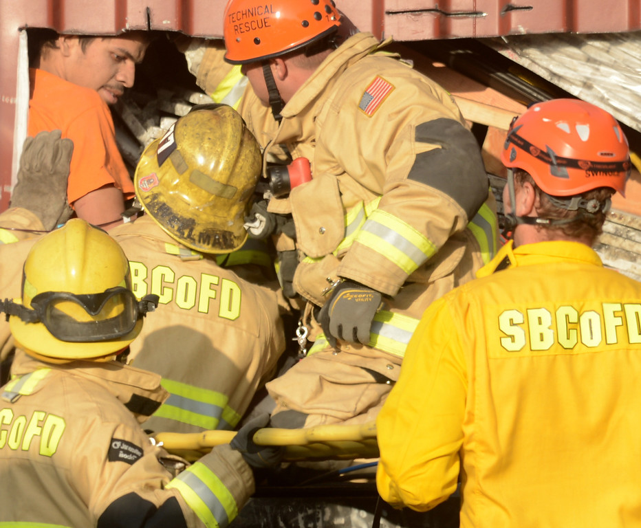 . A 20 year old man rescued by San Bernardino County Firefighters from being crushed by 2000 pounds of granite in a trailer at a contractors business in Fontana April 30, 2013. (Thomas R. Cordova/Staff Photographer)