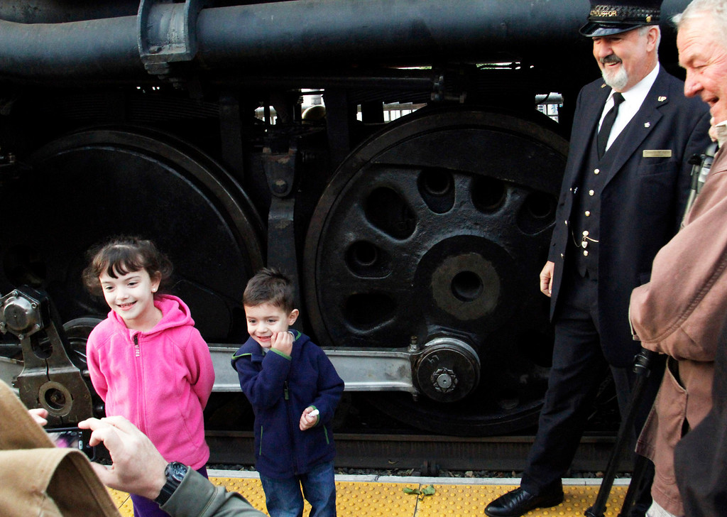 . Chris Faulkner, of Covina, left, takes pictures of his children, Lauren, 6, and Aidan, 4, in front of the historic Big Boy train, weighing 1,200,000 pounds, as it stopped at the Covina Metrolink Station for an hour on its way to Union Pacific\'s Heritage Fleet Operations headquarters in Cheyenne, Wyoming, at the Covina Metrolink Station in Covina, CA., Sunday, January 26, 2014. (Photo by James Carbone for the San Gabriel Valley Tribune)