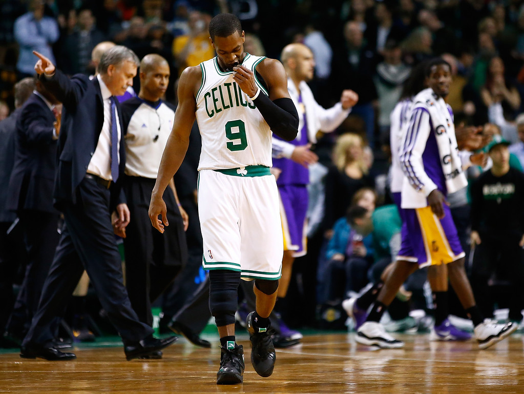 . BOSTON, MA - JANUARY 17: Rajon Rondo #9 of the Boston Celtics walks off of the court following his team\'s 107-104 loss to the Los Angeles Lakers during the game at TD Garden on January 17, 2014 in Boston, Massachusetts.  (Photo by Jared Wickerham/Getty Images)