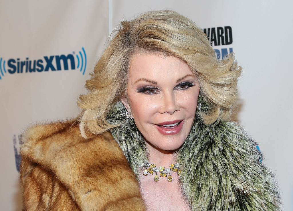 ". Joan Rivers attends SiriusXM\'s ""Howard Stern Birthday Bash\"" at Hammerstein Ballroom on January 31, 2014 in New York City.  Rivers, the raucous, acid-tongued comedian who crashed the male-dominated realm of late-night talk shows and turned Hollywood red carpets into danger zones for badly dressed celebrities, died Thursday, September 4, 2014. She was 81.  http://bit.ly/1puc0CJ   (Photo by Rob Kim/Getty Images)"