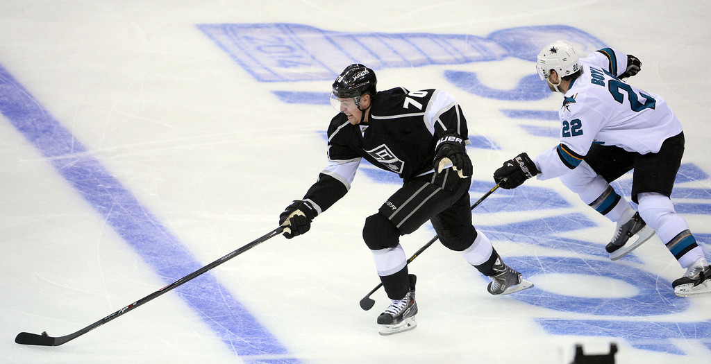 . Los Angeles Kings left wing Tanner Pearson (70) controls the puck past San Jose Sharks defenseman Dan Boyle (22) during the first period in Game 4 of an NHL hockey first-round playoff series at Staples Center in Los Angeles on Thursday, April, 24  2014.  (Keith Birmingham Pasadena Star-News)