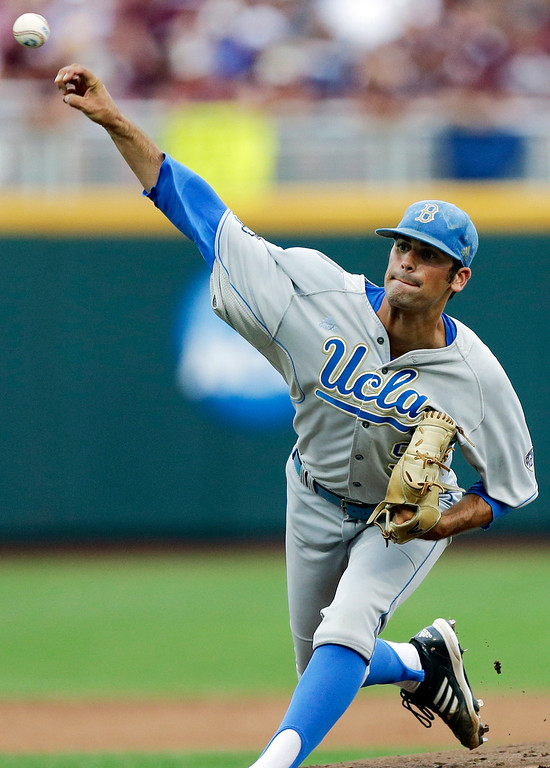. UCLA starting pitcher Adam Plutko delivers against Mississippi State in the first inning of Game 1 of the NCAA College World Series best-of-three finals, Monday, June 24, 2013, in Omaha, Neb.. (AP Photo/Nati Harnik)