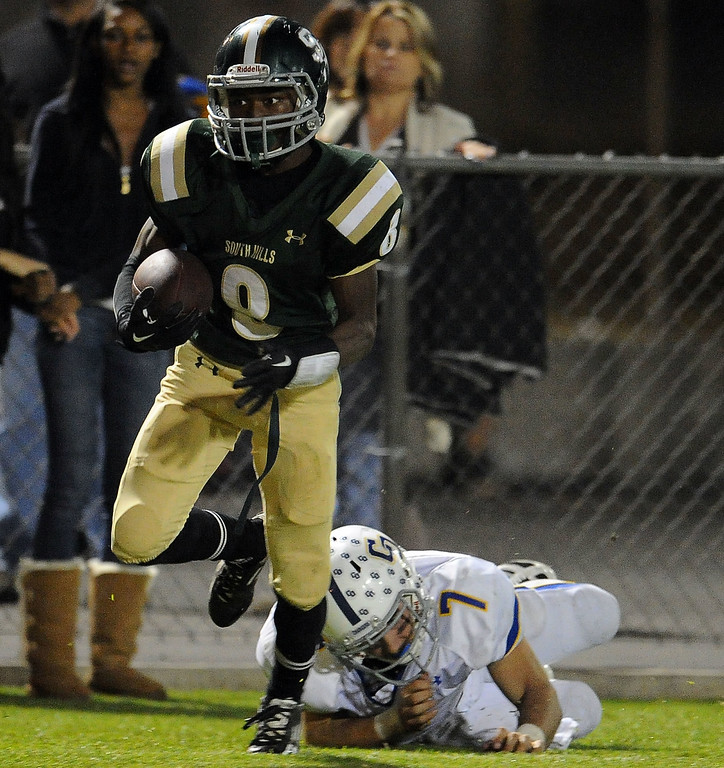 . South Hills\' D Angelo Ross (8) intercepts a pass as Charter Oak quarterback Kory Brown (7) tries for the tackle in the second half of a prep football game at Covina DIstrict Field in Covina, Calif., on Thursday, Oct. 24, 2013. 