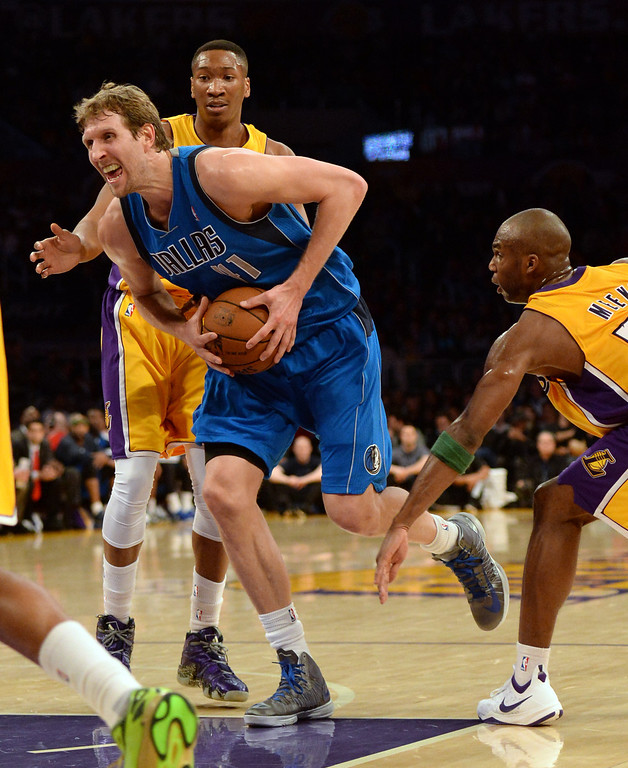 . Dallas Mavericks forward Dirk Nowitzki (41) drives through the Los Angeles Lakers defense in the second half during an NBA basketball game in Los Angeles, Calif., on Friday, April 4, 2014. Dallas Mavericks won 107-95.  (Keith Birmingham Pasadena Star-News)