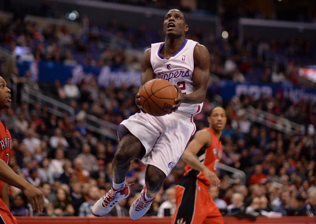 . The Clippers� Darren Collison #2 lays the ball up during their game against the Raptors at the Staples Center in Los Angeles Friday, February 7, 2014. (Photo by Hans Gutknecht/Los Angeles Daily News)