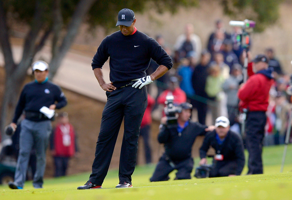 . Tiger Woods reacts after hitting his approach shot into the sand on a playoff hole with Zach Johnson during the final round of the Northwestern Mutual World Challenge golf tournament at Sherwood Country Club, Sunday December 8, 2013, in Thousand Oaks, Calif.   Johnson would go on to beat Tiger Woods.(Andy Holzman/Los Angeles Daily News)