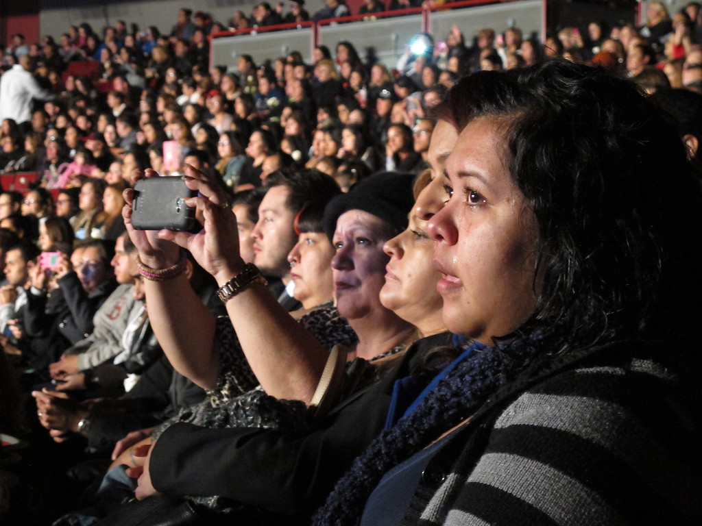 . Jenni Rivera fans watch her memorial service at the Gibson Amphitheatre Wednesday, December 19, 2012, in Universal City. (Michael Owen Baker/Los Angeles Daily News)