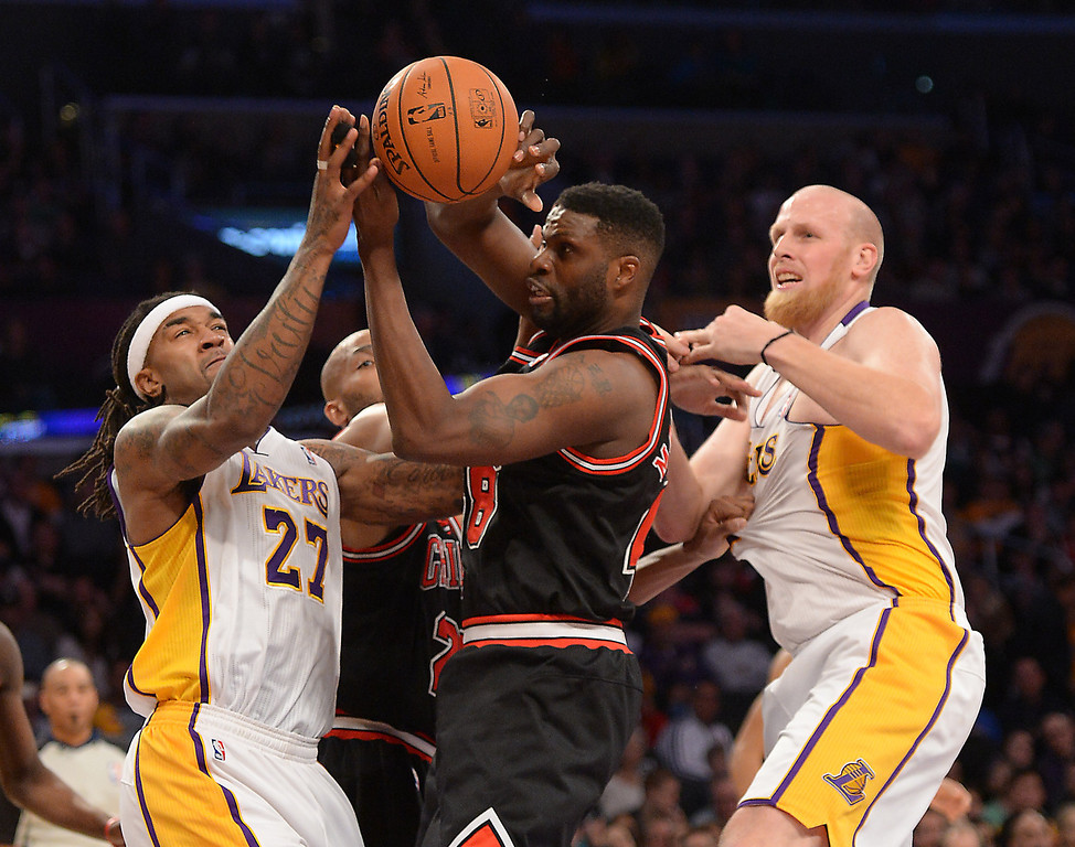 . Los Angeles Lakers\' Jordan Hill, left, and Chris Kaman guard Chicago Bulls\' Nazr Mohammed in the NBA basketball game at Staples Center in Los Angeles, CA. on Sunday, February 9, 2014. (Photo by Sean Hiller/ Daily Breeze).