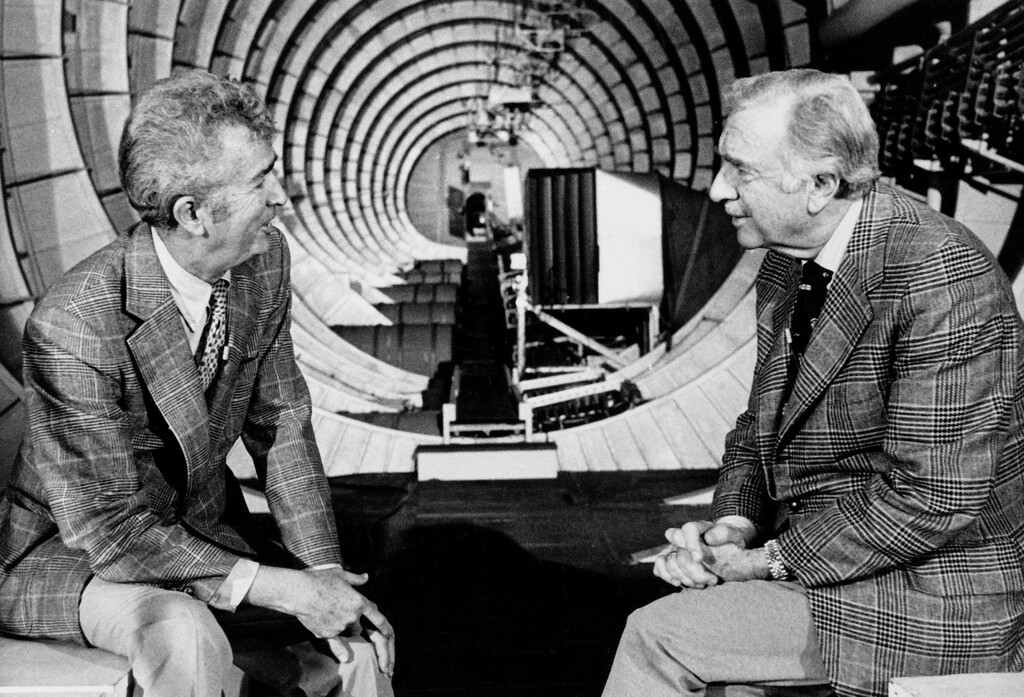 """. Jack Real, Senior Vice-president of Summa Corp. Aviation Group, Left, is interviewed by CBS News correspondent Walter Cronkite inside the hull of Howard Hughes\' Flying Boat, the \""""Spruce Goose,\"""" in its hanger at Long Beach, Calif Feb. 27, 1978. (AP Photo)"""
