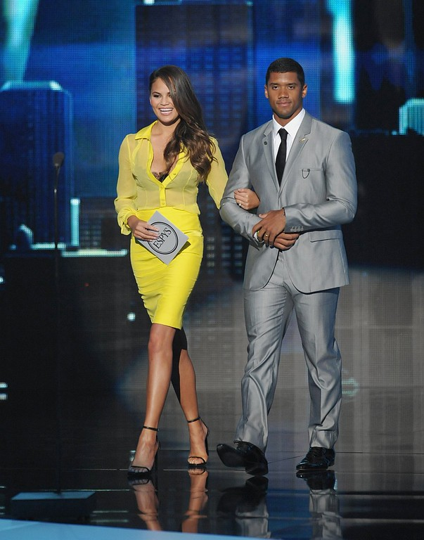 . Chrissy Teigen, left, and NFL player Russell Wilson walk on stage to present an award at the ESPY Awards on Wednesday, July 17, 2013, at Nokia Theater in Los Angeles. (Photo by John Shearer/Invision/AP)
