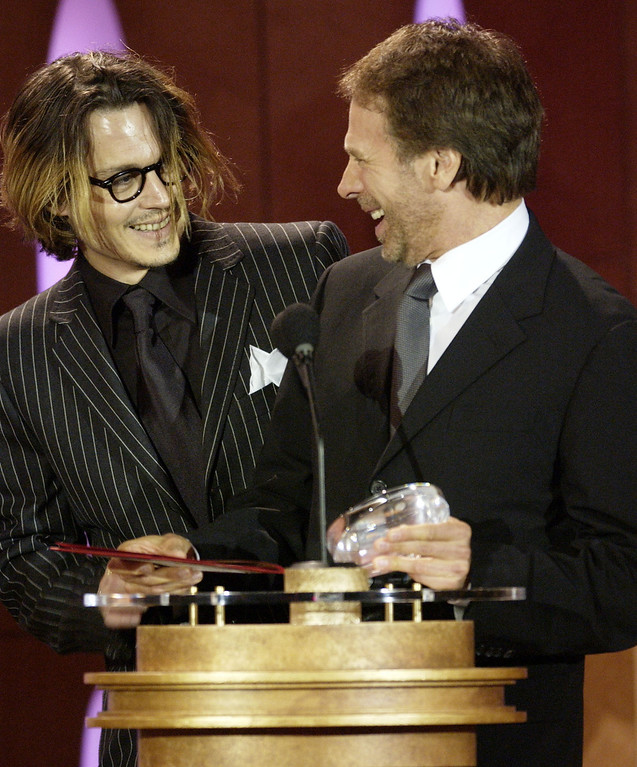 """. Actor Johnny Depp, left, congratulates producer Jerry Bruckheimer for winning the award for best family film at the 9th annual Critics\' Choice Awards, Saturday, Jan. 10, 2004, in Beverly Hills, Calif.  Bruckheimer won the award for \""""Pirates of the Caribbean.\""""  (AP Photo/Chris Weeks)"""
