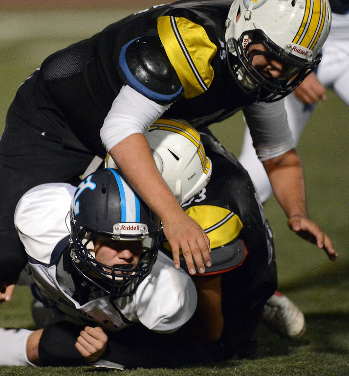 . Bassett defense sacks Duarte quarterback Isaiah Scott in the first half of a prep football game at Bassett High School in La Puente, Calif., on Friday, Nov. 1, 2013.    (Keith Birmingham Pasadena Star-News)