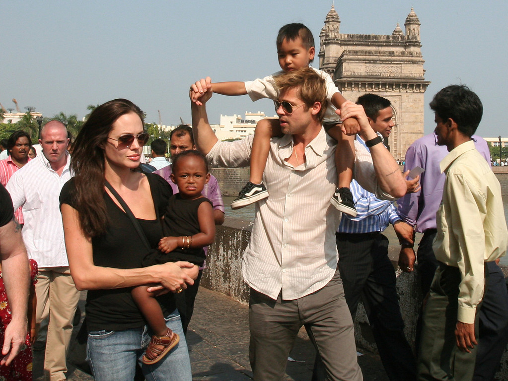 . Actress and UNHCR Ambassador Angelina Jolie, left, with daughter Zahara, and Brad Pitt, second right, with son Maddox, walk near the Gateway of India, in background, in Mumbai, India, in this Nov. 12, 2006 file photo. The megastars were spotted Friday, Aug. 24, 2007 with kids Maddox, Zahara and Pax shopping at Lee\'s Art Shop on West 57th Street. Baby Shiloh was not there. (AP Photo)