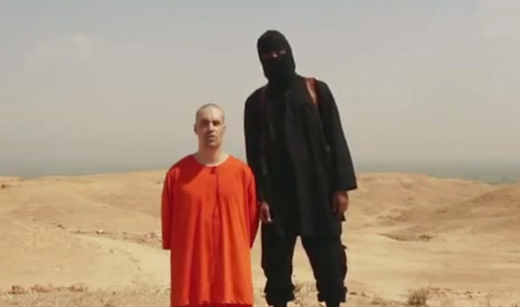 . This undated image shows a frame from a video released by Islamic State militants Tuesday, Aug. 19, 2014, that purports to show the killing of journalist James Foley by the militant group. Foley, from Rochester, N.H., went missing in 2012 in northern Syria while on assignment for Agence France-Press and the Boston-based media company GlobalPost. (AP Photo)