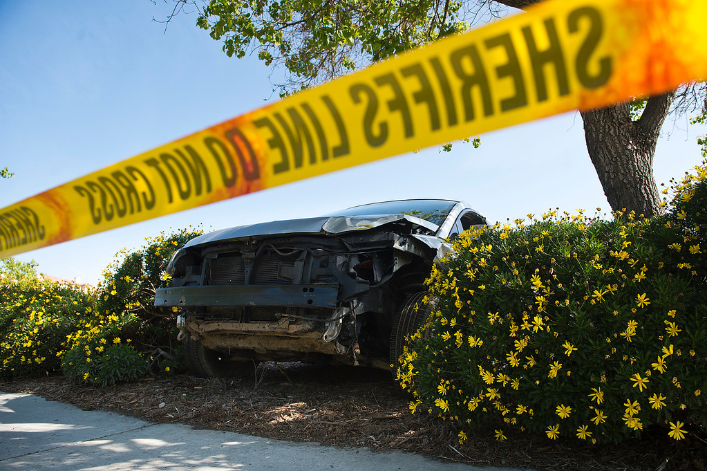 . A male suspect crashed this vehicle after a police pursuit in 16600 block of Butterfield Ranch Road in Chino Hills on Friday, March 28, 2014. The suspect was later fatally shot by the deputies in a nearby neighborhood. (Photo by Watchara Phomicinda/ San Gabriel Valley Tribune)