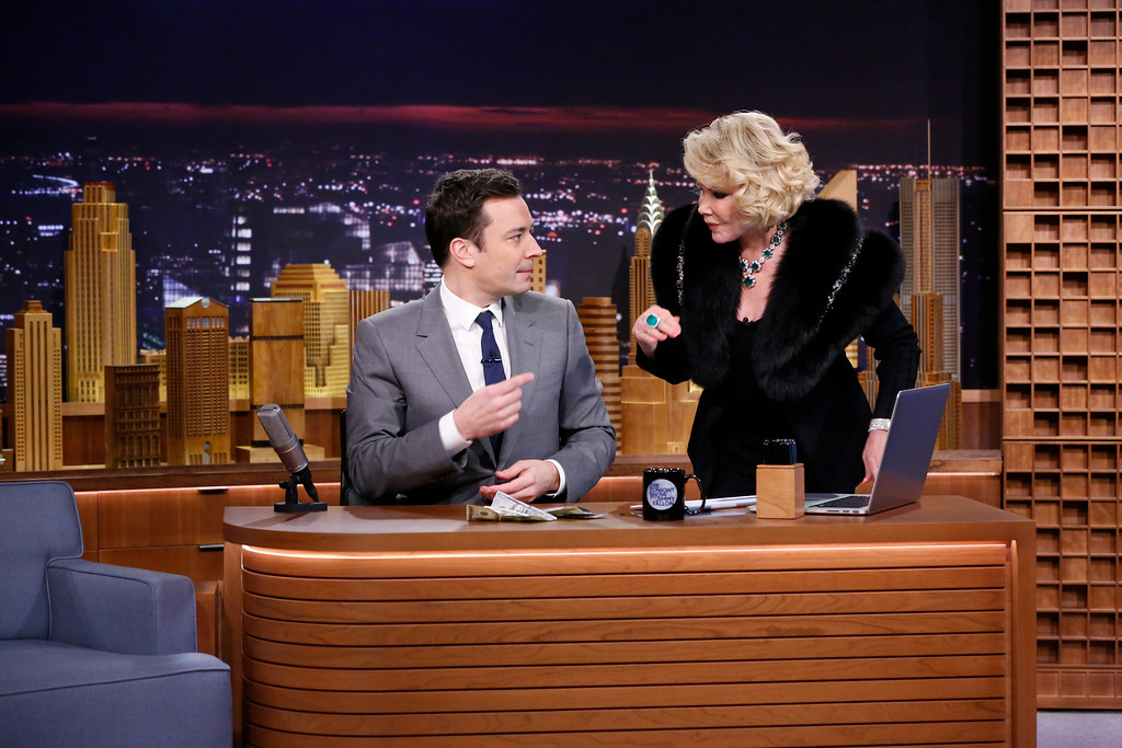 ". In this photo provided by NBC, Jimmy Fallon appears with Joan Rivers, right, during his ""The Tonight Show\"" debut on Monday, Feb. 17, 2014, in New York. Fallon departed from the network\'s �Late Night� on Feb. 7, 2014, after five years as host, and is now the host of �The Tonight Show.� Rivers appeared on the show after 49 years earlier to the day, the veteran comedian had made her first appearance on \""The Tonight Show Starring Johnny Carson\"" in that very studio, and had not appeared on \""Tonight\"" since 1987, when she was banned by Carson after jumping to Fox to host her own short-lived show. (AP Photo/NBC, Lloyd Bishop)"