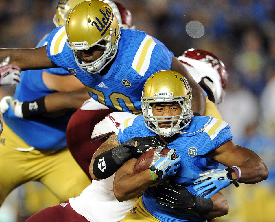 . UCLA running back Jordon James (6) runs for a first down against New Mexico State during the first half of their college football game in the Rose Bowl in Pasadena, Calif., on Saturday, Sept. 21, 2013.   (Keith Birmingham Pasadena Star-News)
