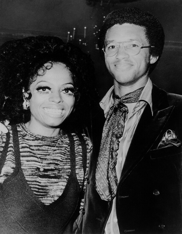 """. Singer Diana Ross, who made her New York debut as a solo act at the Waldorf Astoria Hotel on Wednesday, Sept. 10, 1970 in New York is shown at a party following the opening with Arthur Ashe, who swings a mighty tennis racket. Miss Ross had previously appeared with the singing group, \""""The Supremes.\"""" (AP Photo)"""
