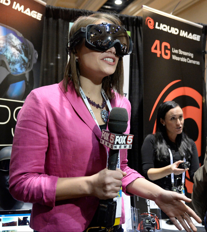 . Fox-5 reporter Linda Curtis tries out the new 3-D recording goggles by Liquid Image during the 2014 Consumer Electronics Show (CES) on Sunday, June 5, 2014 in Las Vegas, Nevada. The 2014 CES show starts Tuesday, Jan. 7, 2014 and runs until Friday, Jan. 10, 2014 with 150,000 people estimated to attend the show. (Photo by Gene Blevins/Los Angeles Daily News)