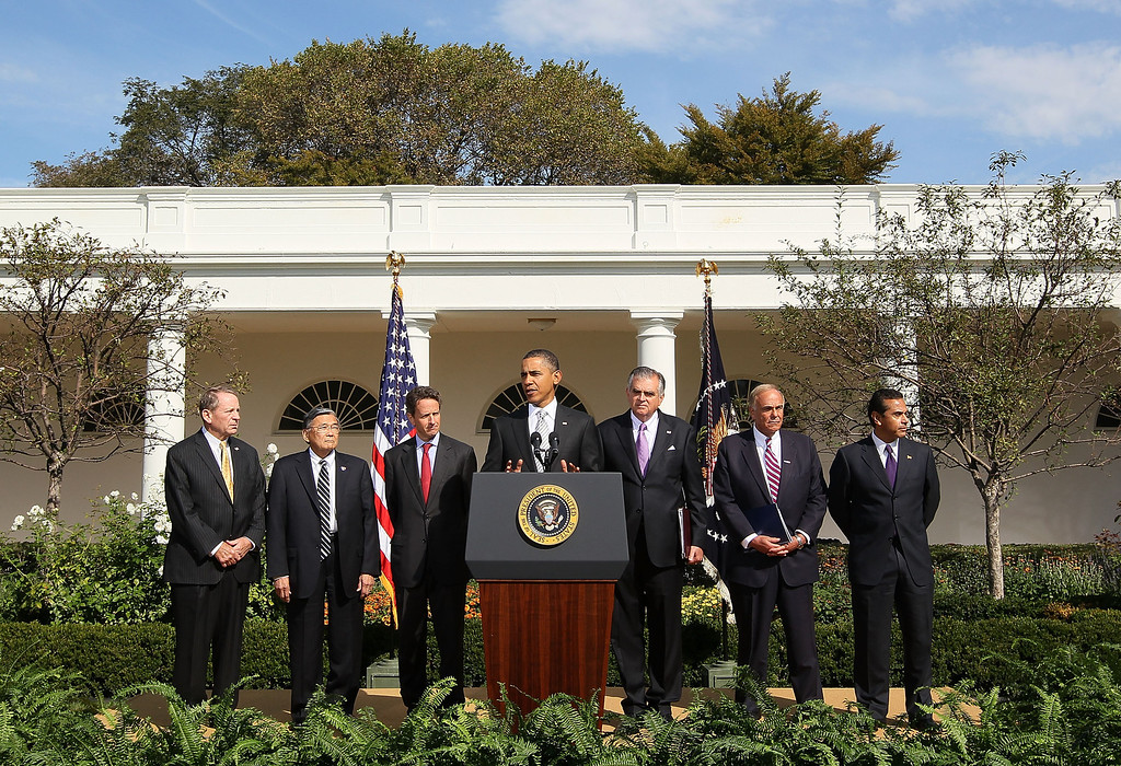 . U.S. President Barack Obama (C) speaks while flanked by (L-R) former Transportation  Secretary Samuel Skinner, former Transportation Secretary Norman Mineta, Treasury Secretary Timothy Geithner ,Secretary of Transportation Ray LaHood, Governors Ed Rendell (D-PA) and Los Angles Mayor Antonio Villaraigosa, during an event in the Rose Garden at the White House on October 11, 2010 in Washington, DC.   (Photo by Mark Wilson/Getty Images)