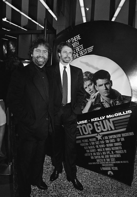 """. Don Simpson, left, and Jerry Bruckheimer, right, the Executive Producers of the movie, \""""Top Gun\'\"""" stand outside the Cinema 1 Theater in San Diego, Calif., Thursday night for the West Coast premier of the movie, May 15, 1986. (AP Photo/Ken Levine)"""