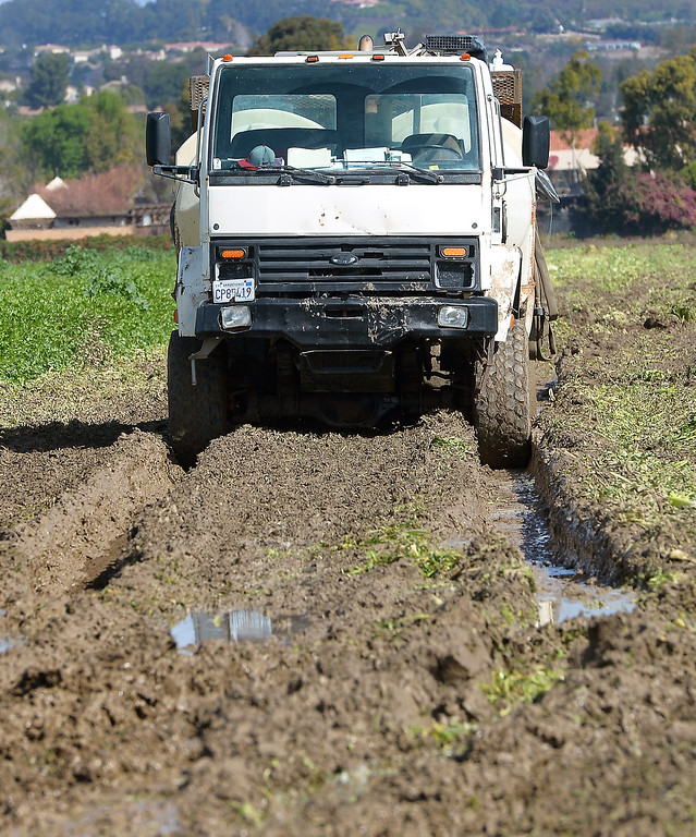 . A truck in a muddy celery field in Camarillo, Thursday, February 27, 2014. (Photo by Michael Owen Baker/L.A. Daily News)