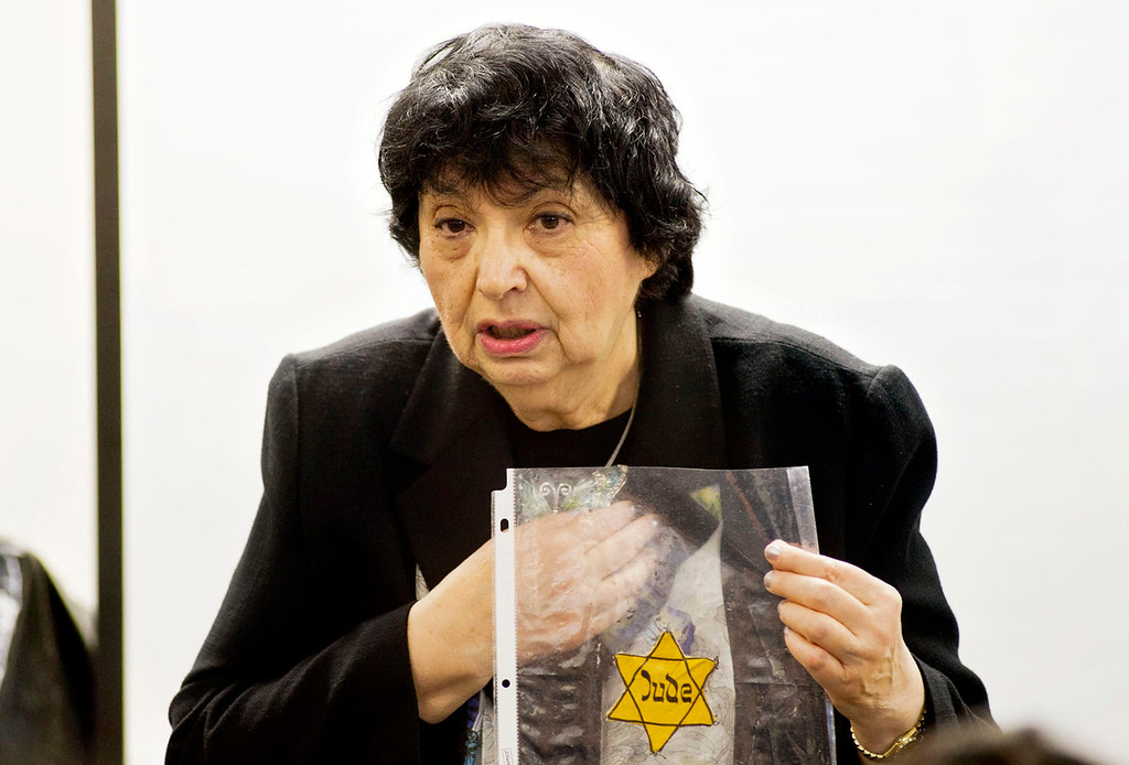 . Inge Auerbacher, 78, one of the Holocaust child survivors, holds at the Star of David that she wore as a child in the Holocaust as she speaks to students at Sierra High School in Glendora on Tuesday, Nov. 12, 2013. Auerbacher told her stories about the time she spent in the Terezin concentration camp. (Photo by Watchara Phomicinda/San Gabriel Valley Tribune)