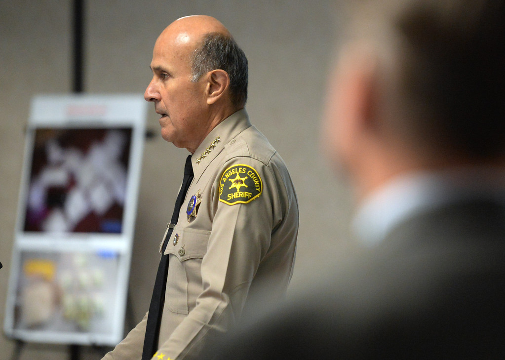 . Los Angeles County Sheriff Department, Sheriff Lee Baca speaks to the media during a press conference where Pasadena Police Officers along with Federal Agents with the San Gabriel Valley Safe Streets Task Force talk about a early morning arrests of multiple area gang members and associates during �Operation Rose Bud,� a multi-agency investigation targeting members of drug trafficking organizations operating in the San Gabriel Valley and Antelope Valley at Pasadena Police Headquarters in Pasadena, Calif., on Thursday, Dec. 12, 2013. 