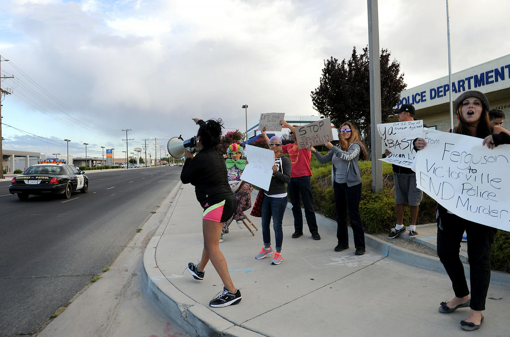 . Pearl Smith, 46, of Victorville, shouts during a protest against police brutality in honor of Dante Parker on Wednesday, August 20, 2014 in Victorville, Ca.  The protest was organized by CopsWatch IE and drew about thirty people. (Photo by Micah Escamilla/The Sun)