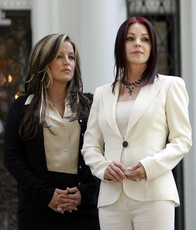 . Lisa Marie Presley, left, and her mother Priscilla Presley await the arrival of  Japanese Prime Minister Junichiro Koizumi and President Bush before they toured  Graceland, the home of Elvis Presley, Friday June 30, 2006 in Memphis, Tenn. Koizumi is a lifelong fan of the late rock and roll legend. (AP Photo/Rob Carr)
