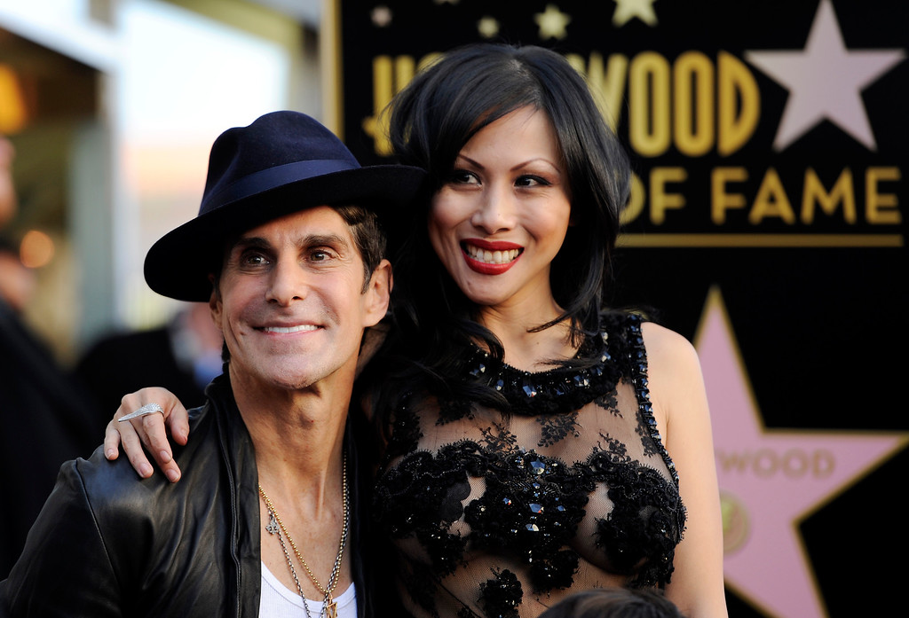 . Perry Farrell, left, lead singer of the band Jane\'s Addiction, poses with his wife Etty Lau after the band received a star on the Hollywood Walk of Fame on Wednesday, Oct. 30, 2013 in Los Angeles. (Photo by Chris Pizzello/Invision/AP)