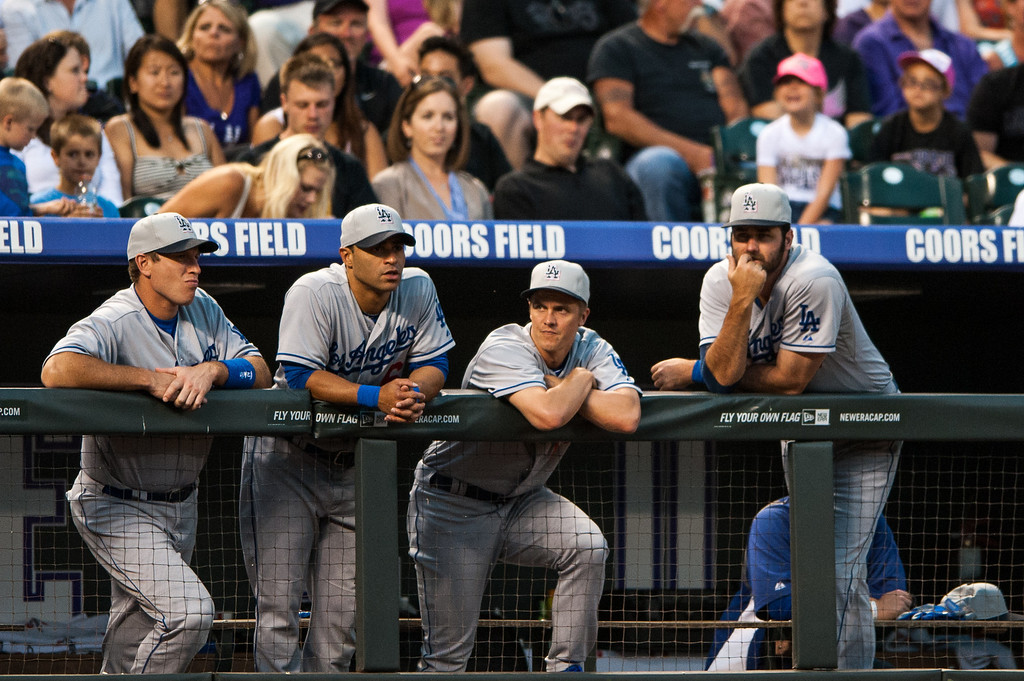 . (L-R) Tim Federowicz #18, Jerry Hairston Jr. #6, Zack Greinke #21 and Skip Schumaker #3 of the Los Angeles Dodgers watch from the dugout during a game against the Colorado Rockies at Coors Field on July 4, 2013 in Denver, Colorado. The Rockies beat the Dodgers 9-5. (Photo by Dustin Bradford/Getty Images)