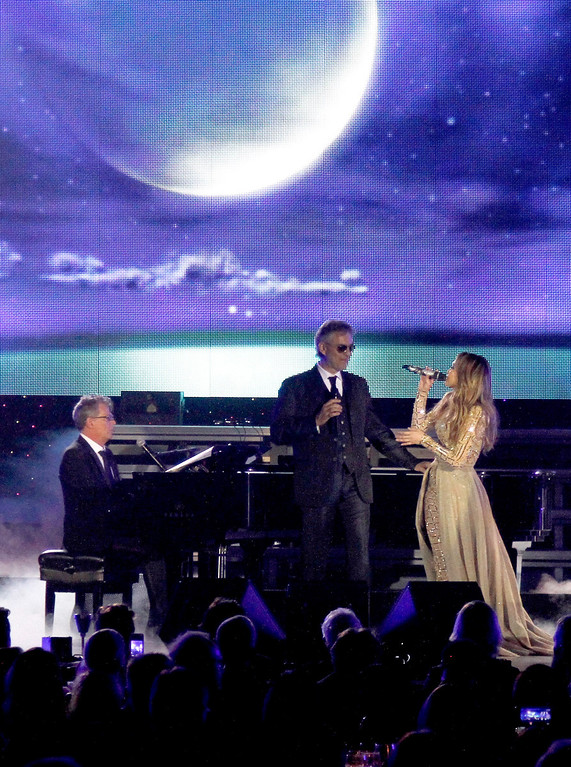 . PHOENIX, AZ - MARCH 23: (L-R) Producer David Foster, singer Andrea Bocelli, and singer Jennifer Lopez attend Muhammad Ali\'s Celebrity Fight Night XIX at JW Marriott Desert Ridge Resort & Spa on March 23, 2013 in Phoenix, Arizona.  (Photo by Mike Moore/Getty Images for Fight Night)