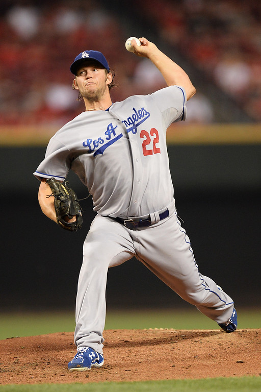 . CINCINNATI, OH - SEPTEMBER 8:  Clayton Kershaw #22 of the Los Angeles Dodgers pitches in the first inning against the Cincinnati Reds at Great American Ball Park on September 8, 2013 in Cincinnati, Ohio.  (Photo by Jamie Sabau/Getty Images)
