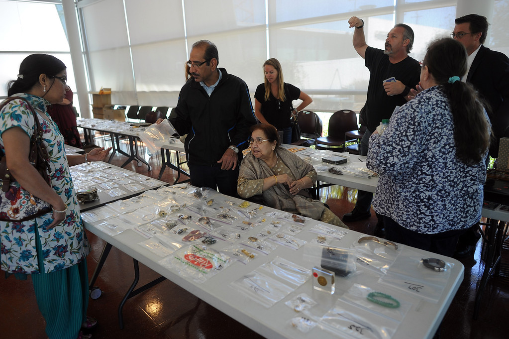 . People look over items during a public viewing of recovered stolen property at LAPD\'S Topanga Division in Canoga Park Thursday, September 26, 2013.  (Photo by Hans Gutknecht/Los Angeles Daily News)