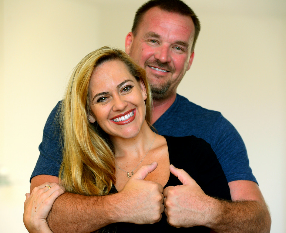 """. Paul Sirimarco signs the word \""""sweetheart\"""" around his fiancee Tina Cleveland. Videos of the Chatsworth couple performing sign-language videos of hit songs have become popular on YouTube. (Photo by Michael Owen Baker/Los Angeles Daily News)"""