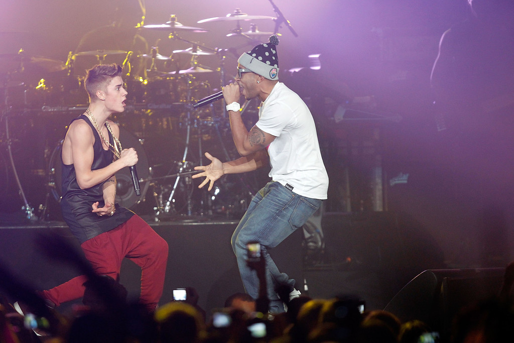 . ATLANTA, GA - DECEMBER 12:  Justin Bieber and Ludacris perform onstage during Power 96.1\'s Jingle Ball 2012 at the Philips Arena on December 12, 2012 in Atlanta.  (Photo by Ben Rose/Getty Images for Jingle Ball 2012)